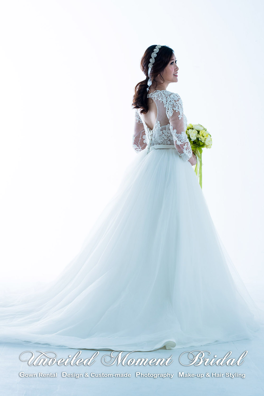 See-through long sleeved wedding gown with a decorative lace bodice, an open back, and a sweep train 透視長袖, 蕾絲釘珠, 美背, 長拖尾婚紗
